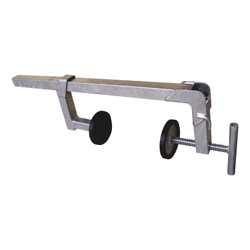 Presse à patin pour fixation d'une protection temporaire en toit plat